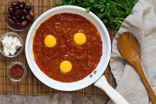 Next add in eggs and cook until eggs are poached and shakshuka is ready.