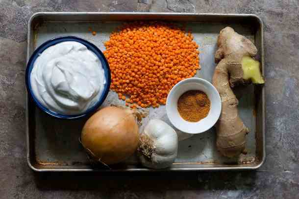 To make curry red lentil soup you need Onion Garlic Ginger Curry powder Red lentils Crushed tomatoes and Coconut milk