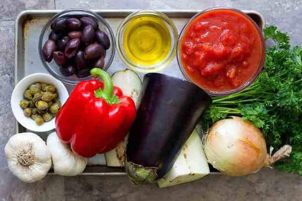 To make this easy eggplant dish, you need the following ingredients: Eggplants Onions Garlic Tomatoes Red bell pepper Olives Capers