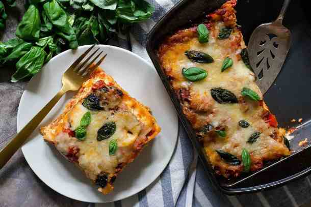 Bake vegetable lasagna in the oven until the noodles are fully cooked.