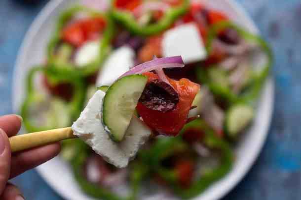 Greek salad has chunks of feta, olives and cucumber.