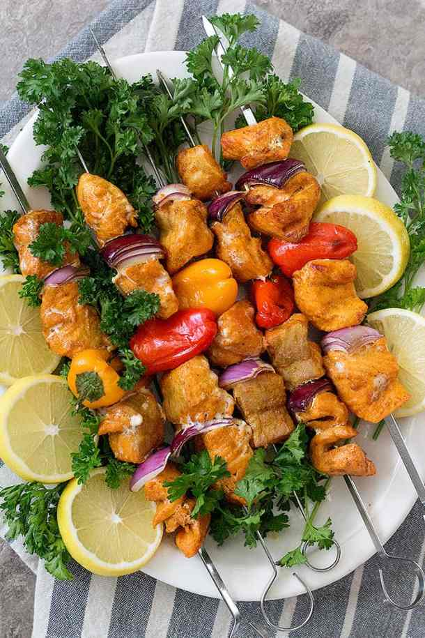 Grilled salmon shish kabobs are hearty, healthy and delicious. Seasoned with tasty spices, these salmon kabobs are easy to make and packed with tons of flavor.
