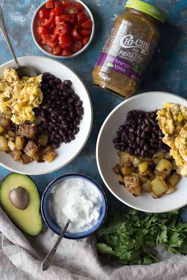 assemble Mexican Breakfast Bowl with with beans eggs and potatoes.