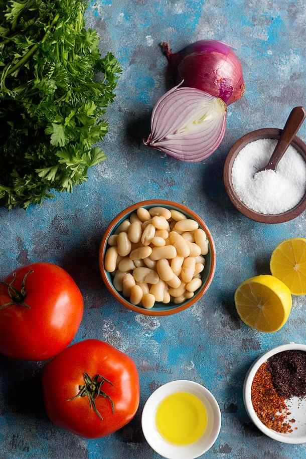 To make turkish white bean salad you need white beans, parsley, lemon, tomato and onions