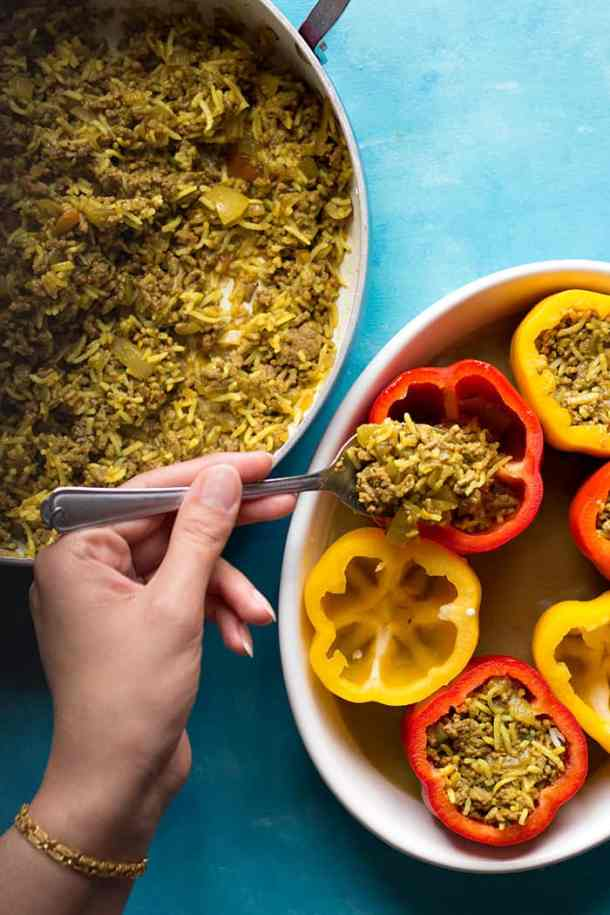 Fill the bell peppers with the rice, beef and salsa mixture and bake in the oven.