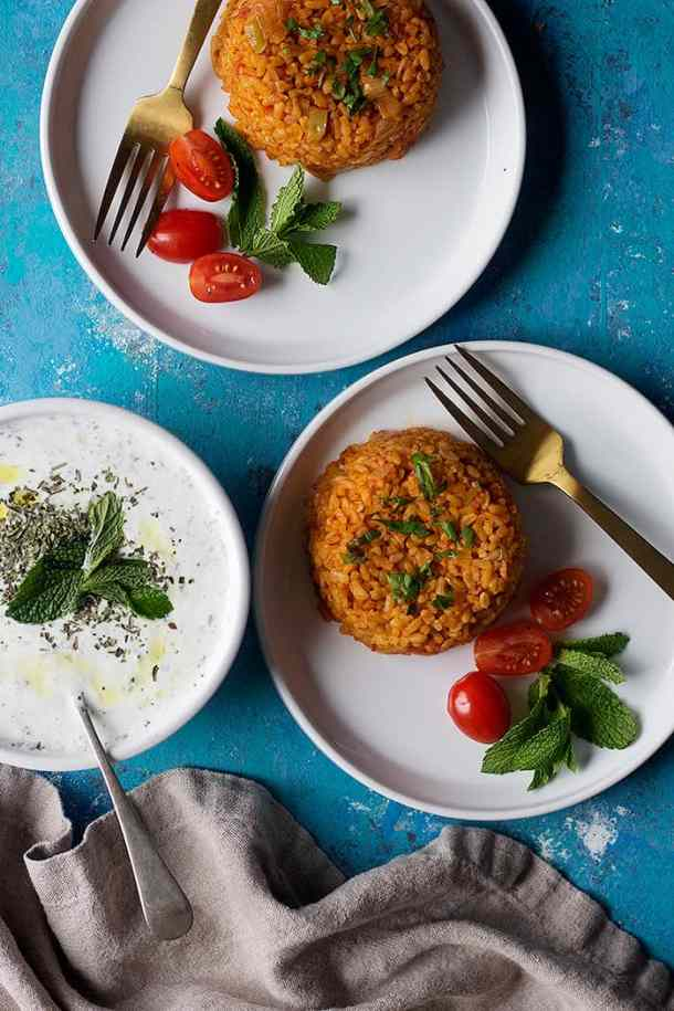 Turkish style bulgur pilaf is a classic hearty and healthy side dish dish that is very easy to make. It's a great alternative to rice and can be served with many dishes.