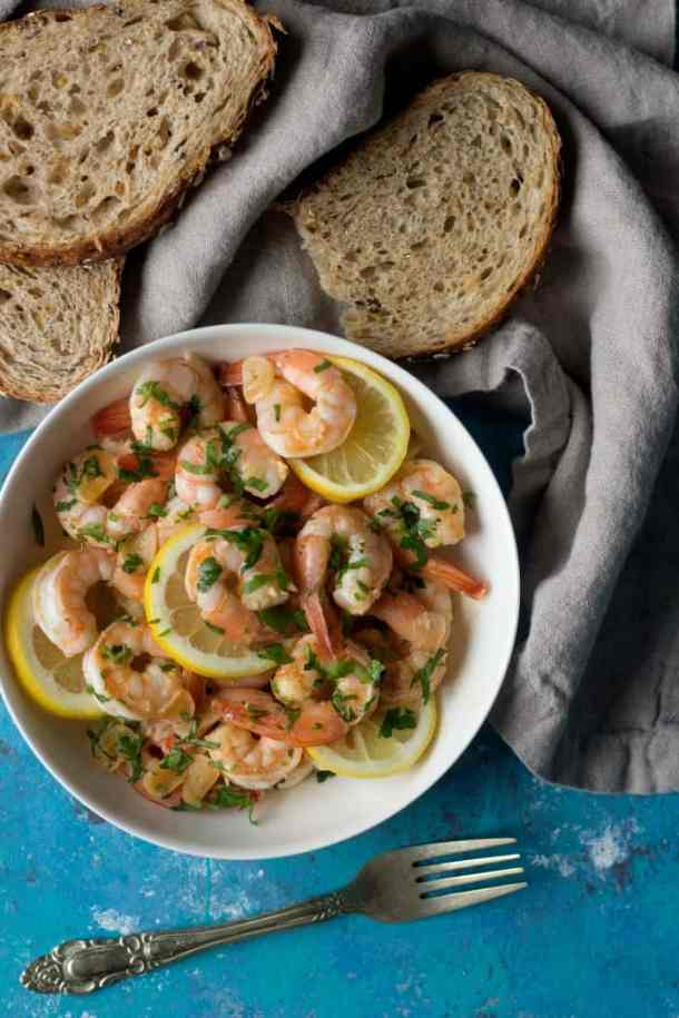 lemon prawns with bread pieces.