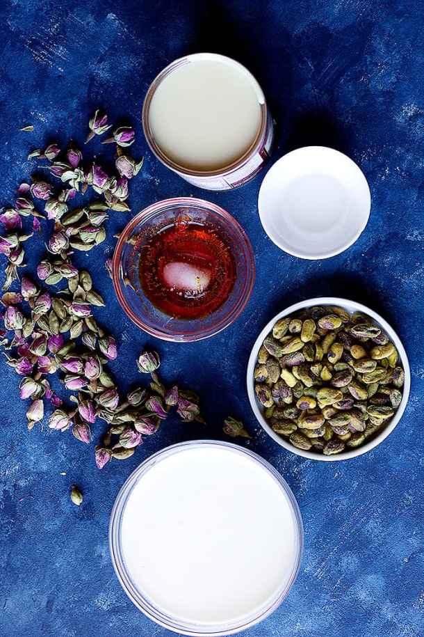 Ingredient shot for saffron no churn ice cream including condensed milk, heavy cream, saffron and pistachios
