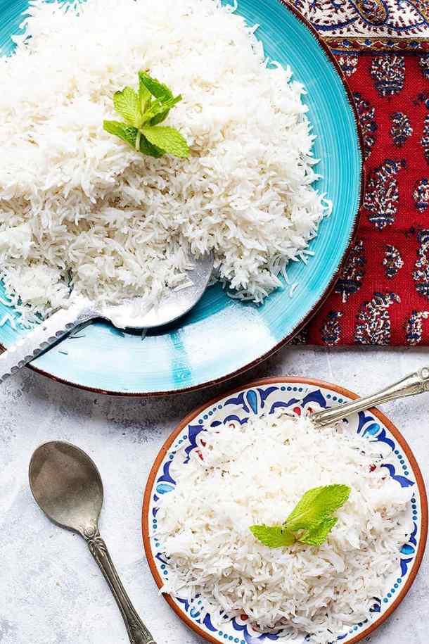 two plates of white rice made in instant pot.