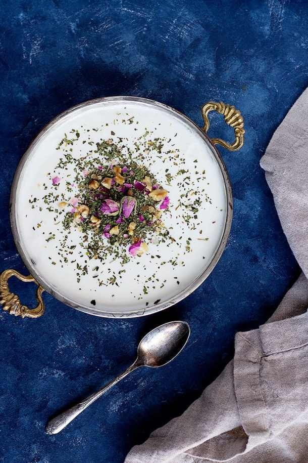 Iranians tend to top yogurt with dried mint and rose petals to serve as an appetizer or side.