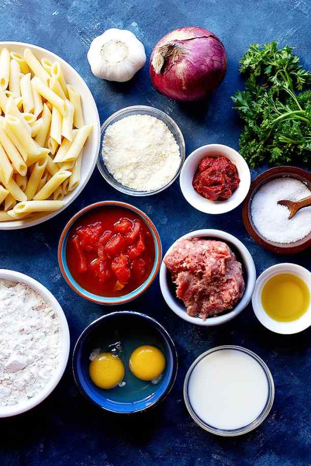 To make pastitsio recipe at home you need onion, pasta, beef and lamb plus tomatoes, eggs, spices, flour and milk.
