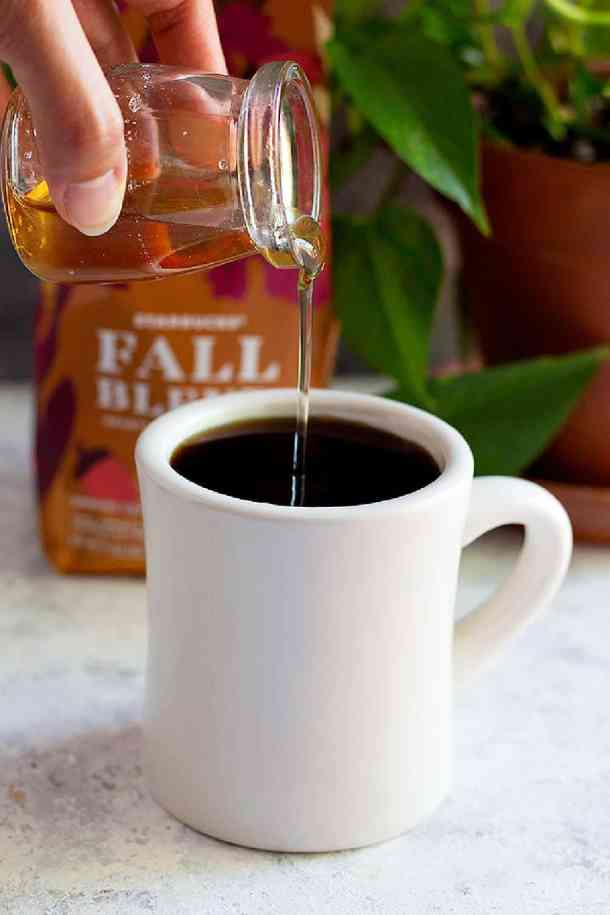 coffee syrup pouring into coffee
