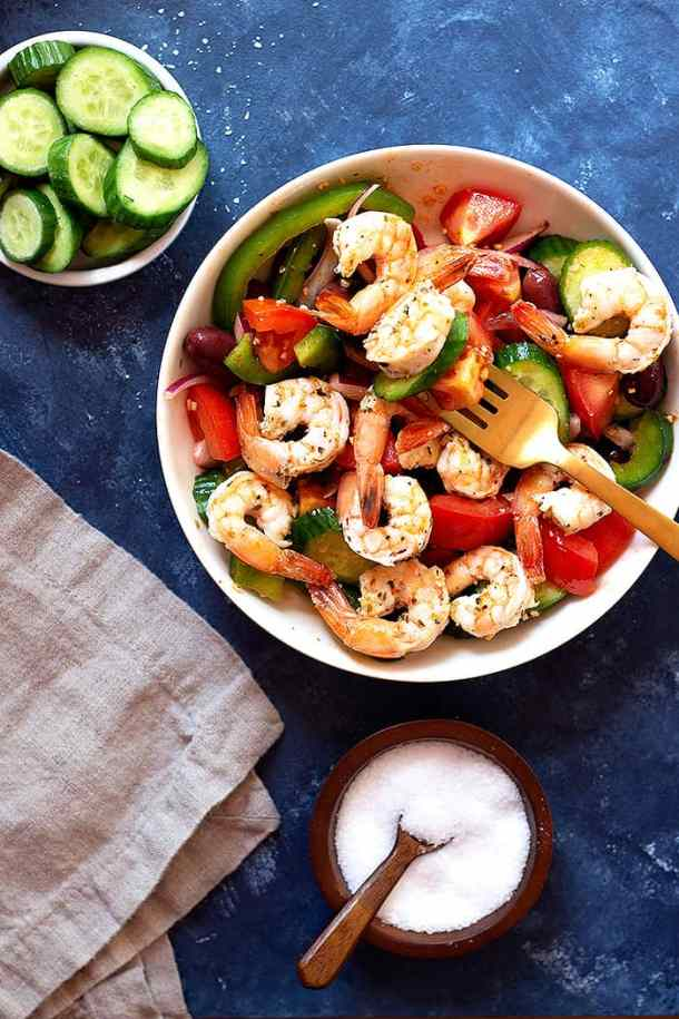 A delicious no mayo Greek shrimp salad recipe that's ready in only 20 minutes. This healthy shrimp salad made with fresh ingredients and is perfect for a light lunch.