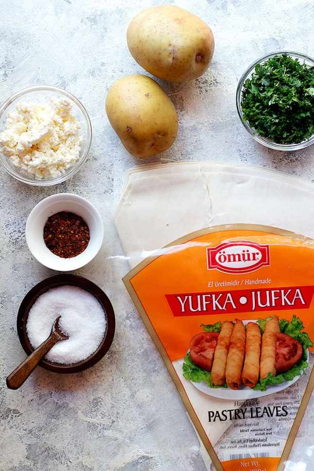To make Turkish rolls you need yufka, cheese, potatoes, parsley, salt and pepper.