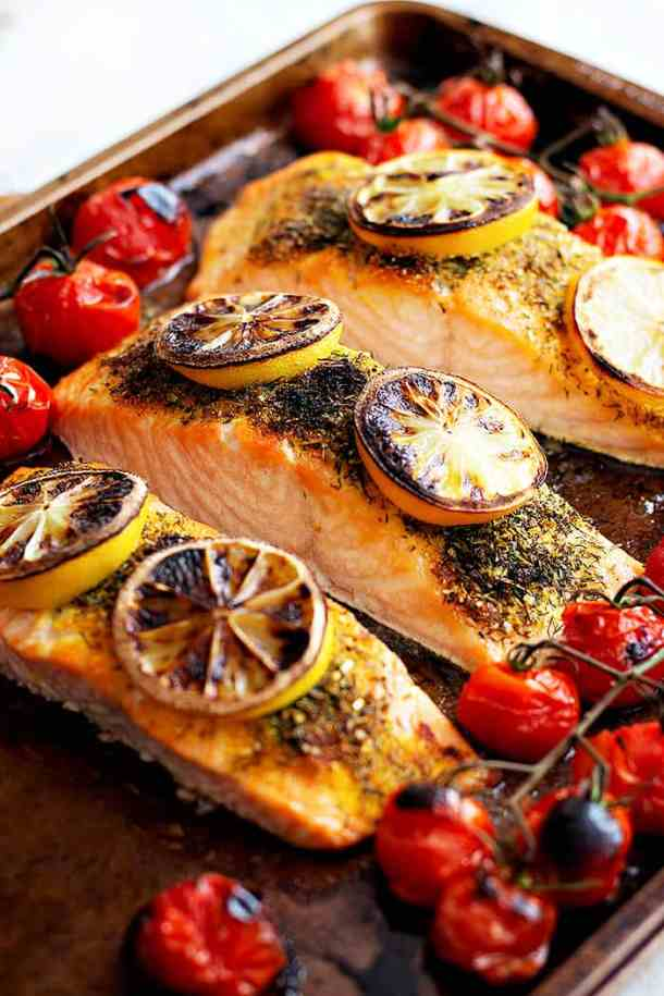 broiled salmon recipe made with salmon fillets and spices on a baking sheet.