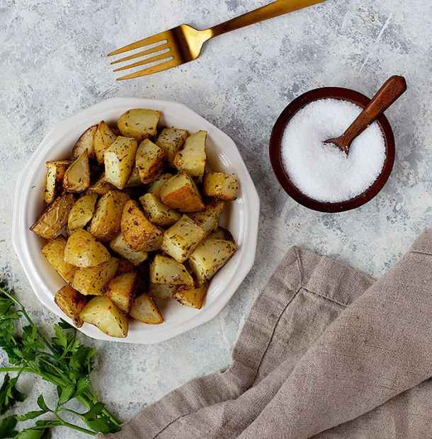 Potatoes are flavored with salt, pepper, oregano and garlic. Then roasted to perfection.
