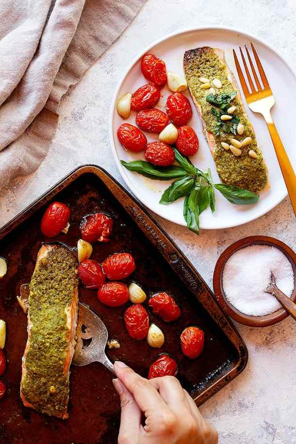 Bake the salmon on a baking sheet with tomatoes and garlic. Serve with some fresh basil and pine nuts.
