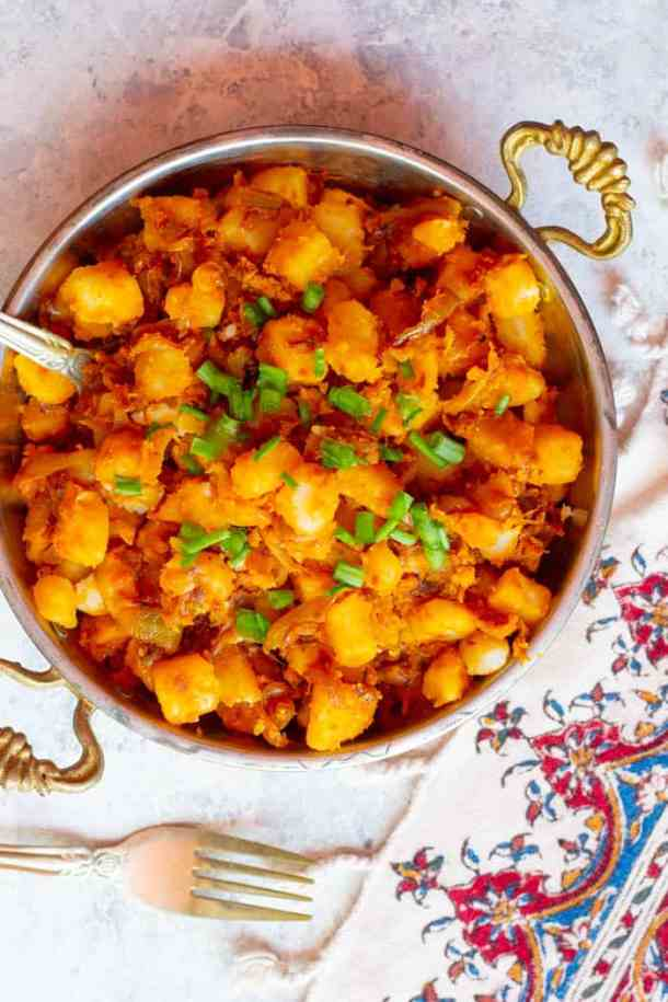 Top fried potatoes and onions with green onions or parsley for more flavor.