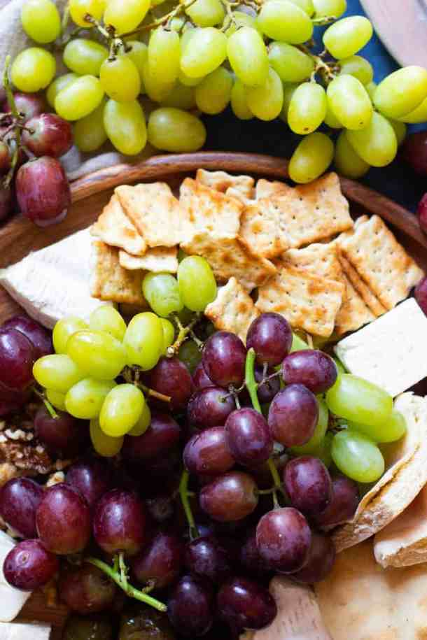 Grapes add a nice color and flavor to this appetizer board.