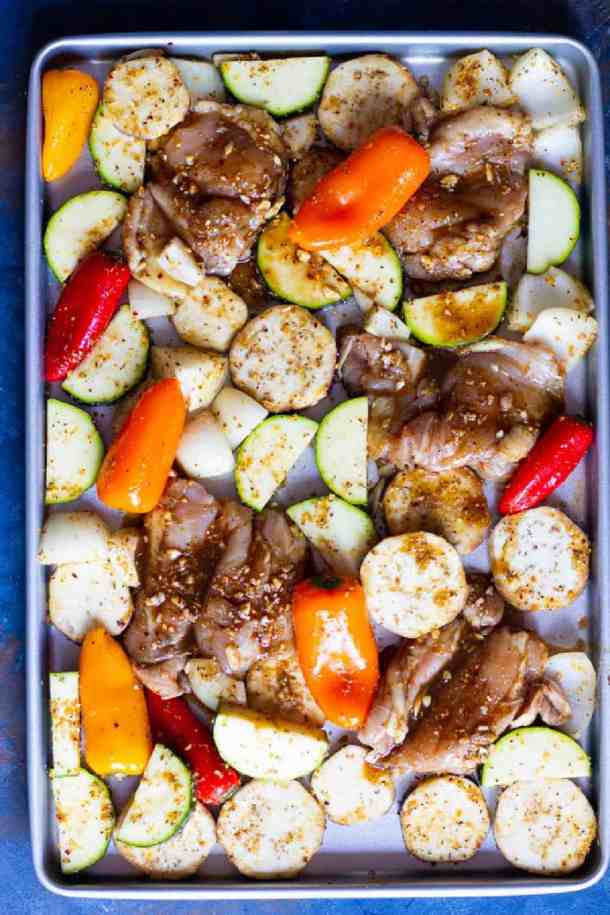 One all the chicken and vegetables are marinated, place them on a sheet pan and bake in the oven.