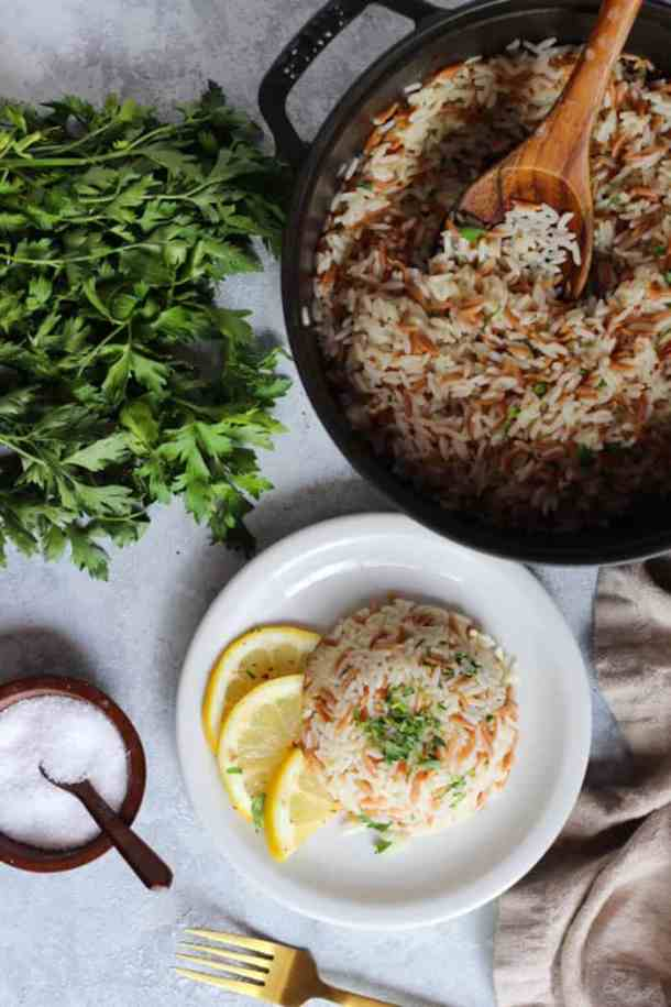 A pot of fluffy rice pilaf and herbs.
