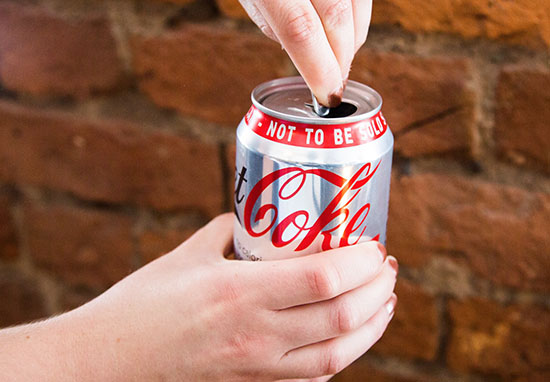 Does Tapping Your Can Actually Stop The Drink Fizzing Up? coke fizz web