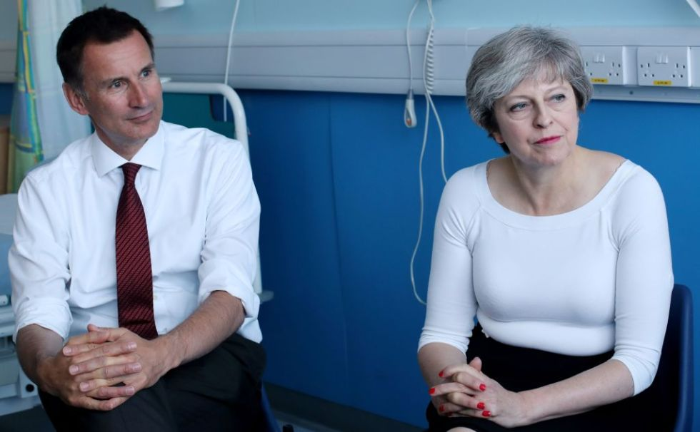 Britain's Prime Minister Theresa May (R) and Britain's Health Secretary Jeremy Hunt