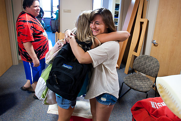 Undergraduate roommates Megan Courtney of Plover, Wis., at left, and Stephanie Weinstein of Potomac, Maryland, hug upon meeting in-person for the first time while moving into Newell Smith Hall at the University of Wisconsin-Madison on Aug. 27, 2010. Nearly 6,500 students are expected to move into 17 residential housing facilities on campus Aug. 25, 27 and 28. ©UW-Madison University Communications 608/262-0067 Photo by: Jeff Miller Date: 08/10 File#: NIKON D3 digital frame 6267