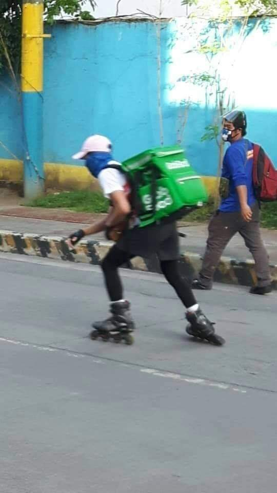 Filipino delivery boy using rollerblades