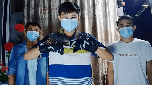 Engineering students presenting the smart gloves that convert Filipino Sign Language to speech