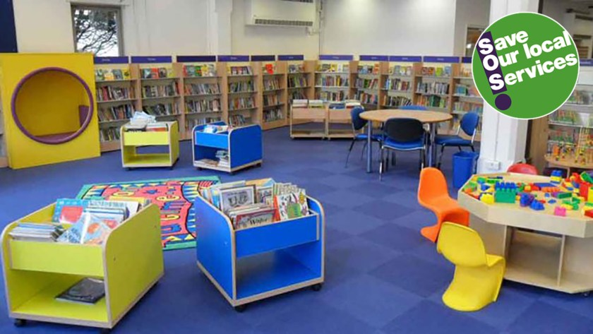 Photograph of library interior with bookcases, tables and chairs for both children and adults. UNISON's 'SOS Save Our Local Service' campaign logo is situated in top-right hand corner.