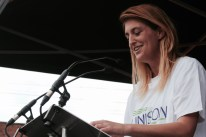 Photograph of Danielle (UNISON Care Workers For Change, UNISON North West) addressing NO MORE AUSTERITY demonstrators at Castle Arena, Manchester.