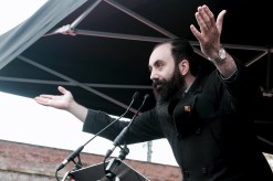 Photograph of Alex Davidson (President, Manchester Trades Union Council) addressing NO MORE AUSTERITY demonstrators at Castle Arena, Manchester.