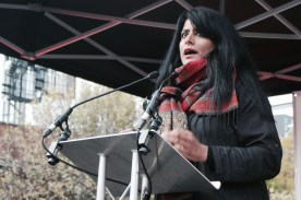 Photograph of Maz Saleem (Stand Up To Trump) addressing NO MORE AUSTERITY demonstrators at Castle Arena, Manchester.