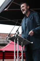 Photograph of Kevin Courtney (Joint General-Secretary, National Education Union (NEU)) addressing NO MORE AUSTERITY demonstrators at Castle Arena, Manchester.