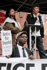 Photograph of Judy Boulton and Moira Samuels (Justice for Grenfell) addressing NO MORE AUSTERITY demonstrators at Castle Arena, Manchester.