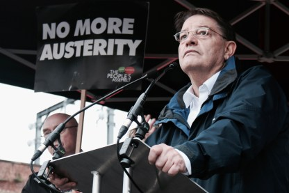Photograph of Pat Karney (Labour Party Councillor, Manchester City Council) addressing NO MORE AUSTERITY demonstrators at Castle Arena, Manchester.