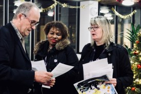 Photograph of UNISON activists and Councillor Ron Woodley discuss fair pay motion before the full meeting fo Southend-on-Sea Borough Council on Thursday 14th December.