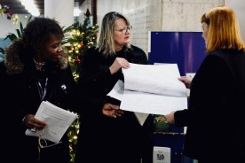 Photograph of UNISON members show a Christmas card to Councillor Helen McDonald signed by the people of Southend demanding an end to Scrooge-like pay rises.