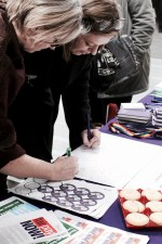 Photograph of Pay Up Now! supporters signing Christmas card to local councillors demanding an end to Scrooge-like pay rises at a protest at the Civic Centre, Southend Borough Council.