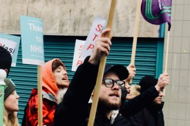 Photograph of Save Our NHS Southend campaigners marching up the High Street, Southend-on-Sea. (27.01.18)