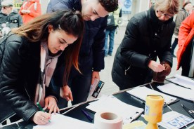 Photograph of supporters signing petition to Save Our NHS Southend at rally at the top of the High Street, Southend-on-Sea.