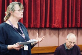 Photograph of Claire Wormald delivering Secretary's Report at AGM 2018.