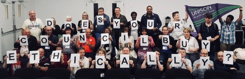 Photograph of 27 UNISON Members holding up letters to spell out the phrase: Does Your Council Buy Ethically?