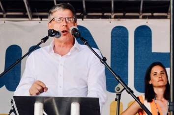 Photograph of Gordon McKay (Mental Health Nurse and UNISON National Executive Council President) addressing 'Our NHS is 70' rally at Westminster, London. (30 June 2018)