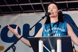 Photograph of Dr Aislinn Macklin-Doherty (Secretary, Health Campaigns Together) addressing 'Our NHS is 70' rally at Westminster, London. (30 June 2018)