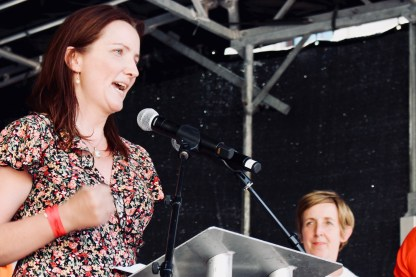 Photograph of Helen O'Connor (GMB) addressing Our NHS is 70 rally at Westminster, London. (30 June 2018)