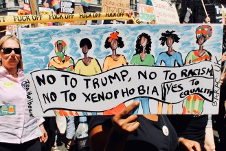 Photograph of placard reading: NO TO TRUMP, NO TO RACISM, NO TO XENOPHOBIA – YES TO EQUALITY
