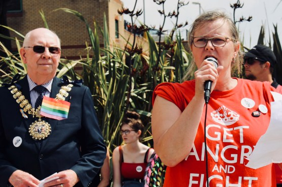 Photograph of Claire Wormald (Secretary, UNISON Southend-on-Sea) addressing Southend Pride Parade at the Royal Plaza, Southend-on-Sea. Mayor of Southend, Councillor Derek Jarvis, in the background.