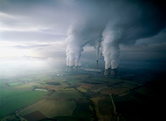 ENVGALLERY NORTH YORKSHIRE, ENGLAND - SEPTEMBER 2003:  Drax is a large coal-fired power station located near Selby in North Yorkshire, England. It provides 7% of the electrical power required by Britain. Although it generates around 1.5 million tonnes of ash and 22.8 million tonnes of carbon dioxide each year, Drax is the most carbon efficient coal-fired powerplant in the UK. In 2005 Drax produced 20.8 million tonnes of carbon dioxide. The Times newspaper reported that this is more than the total amount produced by 103 of the world's small unindustrialized nations. By comparison, vehicles in the UK emitted 91 million tonnes of carbon dioxide. Drax is the biggest single source of carbon dioxide in the UK.  (Photo by Jason Hawkes/Reportage by Getty Images) air above aerial helicopter plane planet earth sky atmosphere pollution ecosystem plant tree nature impact activist green recycle recycling renewable